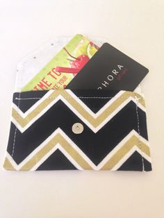Handmade snap wallet in black and gold chevron. Makes a great I. D. Case or cash pouch. https://www.etsy.com/listing/293762163/snap-wallet-black-and-gold-chevron-mini