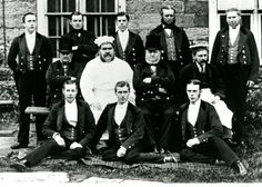 Archival photo of eleven indoor male servants with the chef at Petworth House. (servant research)