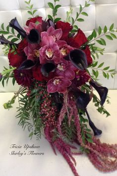 Orchids, Burgandy calla, and Roses wedding bouquet