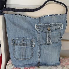 recycled shoulder bag from denim jeans offered by Chapters Unlimited shop on Etsy.