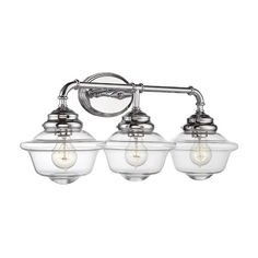 Illuminate your master bath or powder room with this lovely vanity light, showcasing glass shades and a polished chrome finish.   Pr...