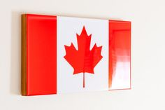 Canada Flag mounted on cradled wood panel with epoxy resin coating