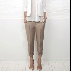Love the white jacket, see-thru button down, the cropped and cuffed chino's, and the SILVER pointy toes heels!!!
