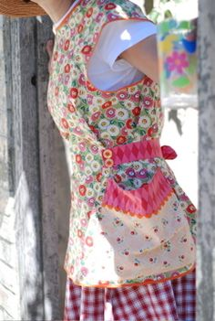 Aprons! like how this is an unusual pinafore/smock style of apron. Cute fabric too. Huge pockets good.