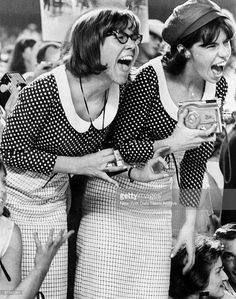 Young Beatles fans let loose with shrieks during concert at Shea Stadium. Beatles played to a packed house of 55,000 fans, some of whom used police barricades to scale stadium walls.