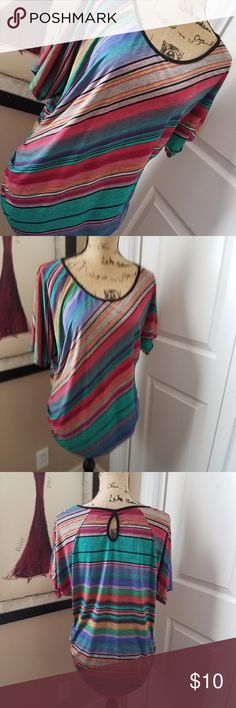 Lavish Striped Top Beautiful diagonal striped design with Autumn colors (hues of orange, yellow, red, green, blue, gray & black). Dress up a pair of jeans with this top. The sides of the bottom are gathered with a keyhole at back of neckline. Normal wash wear (tag with material details is a torn but shows made of polyester) Measurements in photos (no size on tags - please look closely at measurements) Lavish Tops Blouses