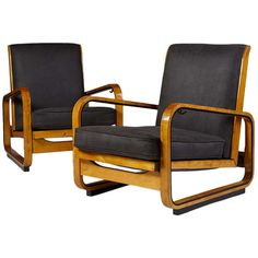 Pair of Adjustable Armchairs, Designed by Erik Chambert | From a unique collection of antique and modern armchairs at http://www.1stdibs.com/furniture/seating/armchairs/