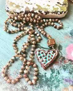 A personal favorite from my Etsy shop https://www.etsy.com/listing/522819012/dainty-boho-glam-czech-hand-knot-heart