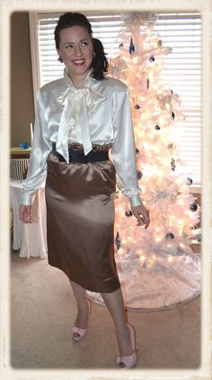 Brown Satin Skirt Ivory Satin Bow Blouse Wide Black Belt Sheer Pantyhose and Pink High Heels