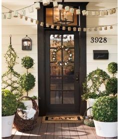black, green, white, cream, brown, numbers, letters, lighting, iron, door, basket, topiaries, pots, rug, wreath