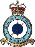 RAF Scamptom Station badge is located adjacent to the A15 road, near to the village of Scampton, Lincolnshire and 6 miles (9.7 km) north west of county town Lincoln in England. RAF Scampton stands on the site of a WWI Royal Flying Corps landing field, originally called Brattleby. The station has remained in operation almost uninterrupted ever since and has provided an airfield for fighters in the First World War, bombers during the Second World War and V-force Avro Vulcans during the Cold…