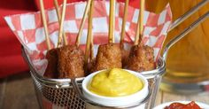 Corn dogs always make me think of summertime, sunshine and carnivals! You can bring these feelings home with this delicious recipe for Mini Corn Dogs!These aren't your average corn dogs, with their itty bitty size and bacon bit batter. You'll love this recipe for parties and