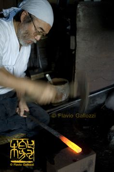 Japanese katana maker master Fujiyasu Masahira hammering the hot metal. Photo © Flavio Gallozzi - All rights reserved.