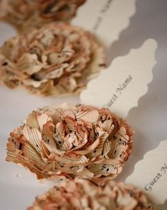 Paper flowers are popular...these are cute done with sheet music.....
