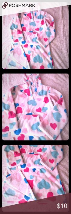 """Pullover Bath Robe. Special price! This pullover bathrobe has a hood and a Kangaroo Pouch and is covered in Pink & Blue hearts. Cute and comfy when u don't need a full bathrobe. Has some fuzzies, but mainly from washing. It hasn't been worn but a few times. It does have a small spot on the back (pic 6). Not that noticeable at all! Also perfect to wear around the house while getting ready but don't want a full robe. Has an 8"""" slit up the sides. Any other questions I'll be happy to answer…"""