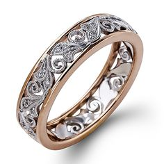 Melody Collection - This fabulous 18K white and rose gold ring is comprised of .11ctw round white Diamonds. - MR2354-R A perfect wedding band or even anniversary band. Try it on today at SVS Fine Jewelry 2947 Long Beach Rd. Oceanside NY 11572 or call (516) 766-2614 for more details.