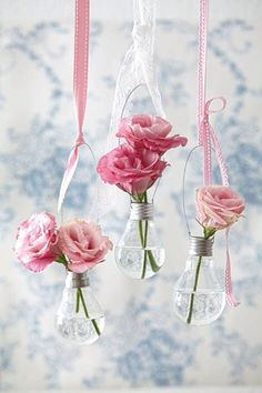 Hanging glass vase & pink flowers