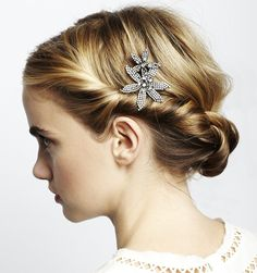 These two Swarovski crystal studded orchids on a high quality bobby pin can be worn anywhere in the hair, next to a loose bun or to pin back overgrown bangs. Try nestling these flowers into an intricate braid for a romantic look. Handmade in New York. $352.00