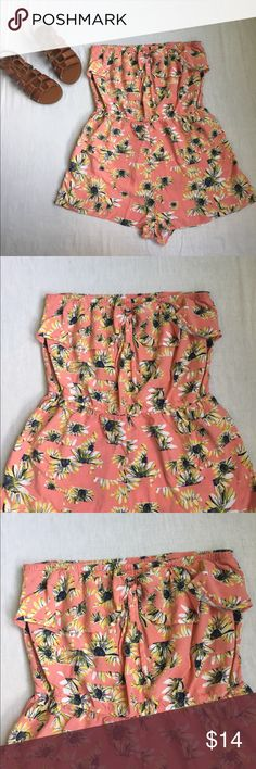 American Rag Romper American Rag Strapless Sunflower Romper. Pairs great with sandals, perfect for summer! American Rag Pants Jumpsuits & Rompers