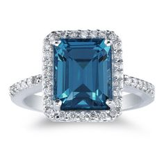 applesofgold.com - A large emerald-cut 4.70 Carat London Blue Topaz gemstone set in 14k white gold with 0.38 carats of high quality diamonds.