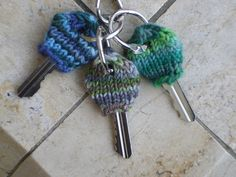 key cozies... free pattern - not crochet but, I'm sure it can't be that hard to figure out! Love the idea!