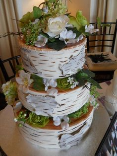 Another lovely cake by Ooo La La Creative Cakes transforms fondant to look like peeling birch bark.
