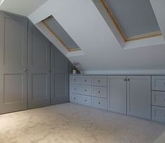 Significance of shaker style fitted bedroom furniture Fitted wardrobes built into loft conversion. Storage drawer units shaker style doors and drawers. Pull out hanging rails. furniture layout windows Significance of shaker style fitted bedroom furniture Attic Loft, Loft Room, Attic Rooms, Bedroom Loft, Attic Bedroom Storage, Garage Attic, Attic Playroom, Eaves Bedroom, Attic Bedroom Closets