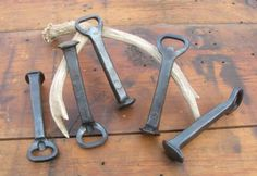 Hand Forged Bottle Openers from recycled Railroad spikes.