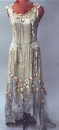 ~Boué Soeurs, ca. 1928 Brocade silver lame, blue net, silk floral trim, sequins. Chemise style, sleeveless, dropped waist, net trim at hem. Possible robe de style dress, missing panniers~