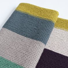 Colour Story baby blanket is a stunning yet easy to knit blanket, perfect for all levels of knitting, it is a simple garter stitch baby blanket knit end to end as one piece.