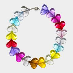 The love stories that color a life inspire the design for this sculptural necklace composed of acrylic hearts with a crackle effect. Magnetic closure.