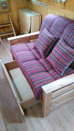 Aylesbury sofa bed in aubergine/red stripe fabric.