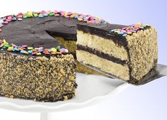 Golden Fudge Celebration Cake Two layers of yellow cake topped with a rich and creamy fudge frosting, celebration confetti sprinkles, and toasted-golden cake crumbs all around the side.