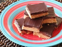 Easiest No Bake Peanut Butter Bars: 1 cup (2 sticks) unsalted butter,2 cups animal cracker crumbs (or vanilla wafers, graham crackers, etc) , 2 cups powdered sugar , 1 1/2 cup creamy peanut butter. For the Topping: 1/4 cup peanut butter , 10 ounces semi-sweet chocolate