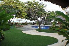 A small resort, popular with the tourists for its services. The green landscape creates a serene ambience at the Suites Hotel Bali Royal in Tanjung Benoa Beach, Bali. This hotel offers a swimming pool, a restaurant and a bar. beach surface. #luxury #resort #pool #garden #holiday #beautiful #travel #bali #indonesia  http://thebeachfrontclub.com/beach-hotel/asia/indonesia/bali/tanjung-benoa-1/suites-hotel-bali-royal/#overview