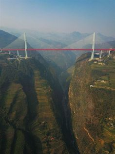 The Duge Bridge in China is the highest bridge in the world with the road deck sitting over 565 metres feet) above the Beipan River In China, Places To Travel, Places To See, Places Around The World, Around The Worlds, Bridges Architecture, Scary Bridges, Cable Stayed Bridge, High Bridge
