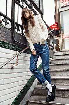 street style 2014 | rolled & cuffed vintage jeans styled with socks pulled up and loafers | chunky knit cable sweater
