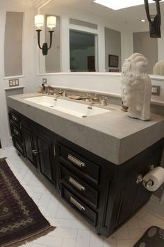 I want this sink in my bathroom! One long sink to share instead of 2 sinks with awkward counter space in the middle.