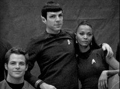 Chris Pine, Zachary Quinto, and Zoe Saldana on the set of Star Trek.