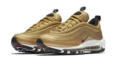The NIKE AIR MAX 97 'METALLIC GOLD' brings the Midas touch to one of the most exciting Air Max retros we've seen. The Nike Air Max 97 was a neck-breaking release when it first dropped 20 years ago. Christian Tresser's futuristic design was inspired by spe Air Max 97, Air Max Plus, Tenis Nike Air Max, Zapatillas Nike Air, Air Max Sneakers, Sneakers Nike, Nike Shoes, Mens Shoes Uk, Nike Gold
