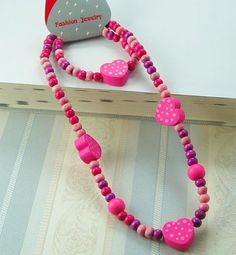 Set 26 A set of necklace and bracelet  Made from wood Shape : heart  From China  RM10 per set  PRE ORDER now..