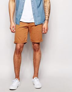 "Chino shorts by Weekday Soft-touch twill Concealed zip fly Two front and two back pockets Turn-up hem Slim fit - cut closely to the body Machine wash 100% Cotton Our model wears a 32""/81cm regular and is 188cm/6'2"" tall"