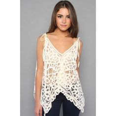 Free People Lace Top Super cute convertible lace tank with adjustable straps.  Perfect for spring/summer.  Cream colored throughout.  Size XS/S.  In excellent condition.  No trades/modeling.  More photos to come.     Tags: Follow game tank top blouse shirt Free People Tops