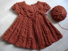 found on Pinterest as :FREE PATTERN: Beautiful #knit baby dress! pattern appears to be adult cardigan .....am going to try to convert .....andyj