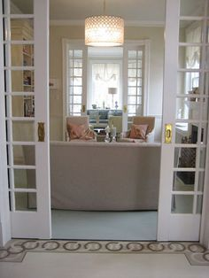 beautiful glass french pocket doors. Great way to divide rooms but make them still flow and not take up space.