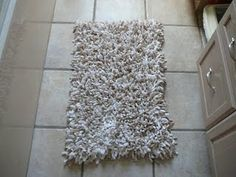 DIY bathroom rug. You can find the pad at Dollar Tree. It takes a longgggg time to finish, the towel starts to fray and it's very very messy.