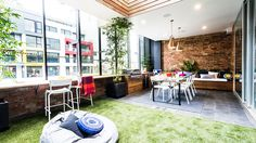 Indoor terrace - exposed brick wall with deep bench seating, copper pendant lights and fake grass