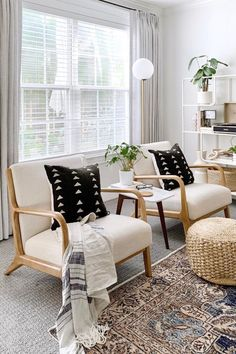 This inviting Scandi boho living room features Mist Gray EuroPleat drapes from Barn & Willow. Grey Interior Design, Bohemian Living Rooms, Living Room Goals, African Mud Cloth, Minimal Decor, Tray Decor, Living Room Inspiration, Throw Pillows, Furniture