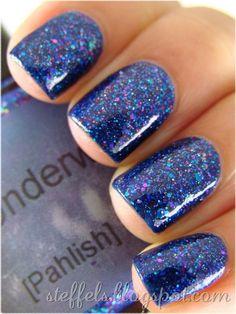 """Pahlish - Train Underwater.  The """"Pahlish"""" that started it all is back for a limited time only in honor of our third anniversary!  Train Underwater is a deep blue jelly filled with a mix of pink, red, gold, and holographic turquoise micro glitter and scattered medium blue hex glitter!  *Please note that this shade will come with the newer style label, we just loved the original swatch picture too much to replace it!"""
