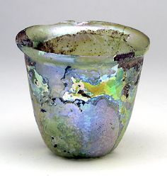 "Beaker with Fine Iridescence. Roman, c. 2nd to 3rd century AD. Height: 3-1/4"".  $546"